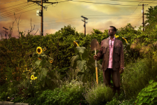 Ron Finley reflects stoically in his garden.